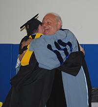 Dr. Macchiarola hugging a student